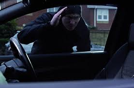 Car burglar looking in window